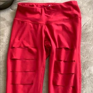 Red Capri leggings with cutout slits and mesh